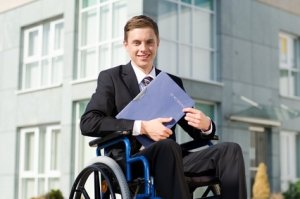 young man in a wheel chair wearing business suit