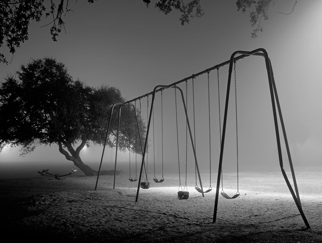 empty swing set at night