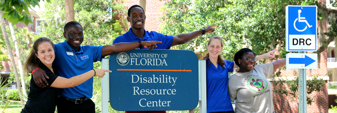 Group of students pointing towards Disability Resource Center