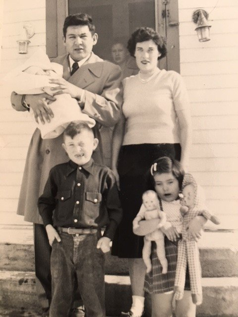 Sherry Salway Black is an infant in her father's arms in this family photo taken in Pine Ridge Village.