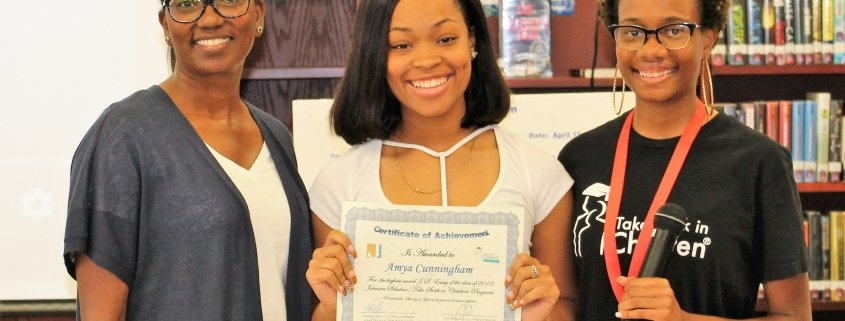 Student holding certificate of achievement